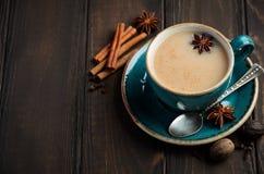 Indian masala chai tea. Spiced tea with milk on dark  wooden background. Indian masala chai tea. Spiced tea with milk on dark wooden background, selective focus Royalty Free Stock Photo