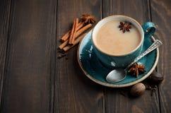 Indian masala chai tea. Spiced tea with milk on dark  wooden background. Indian masala chai tea. Spiced tea with milk on dark  wooden background, selective Royalty Free Stock Photo
