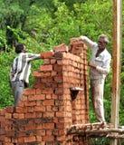 Indian mason laborers. Building a brick wall royalty free stock photos