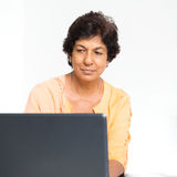 Indian mature woman using laptop computer Stock Photos