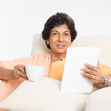 Indian mature woman using social media Royalty Free Stock Photos