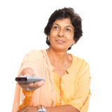 Indian mature woman watching tv Royalty Free Stock Photography