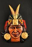 Indian Mayan Aztec ceramic mask with feather  on black Royalty Free Stock Image