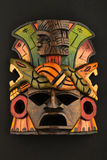 Indian Mayan Aztec wooden carved painted mask  on black Royalty Free Stock Photo