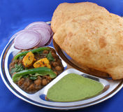Indian Meal. An Indian meal served in a typical metal tray, consisting of Indian bread, gravy, stewed peas and potatoes and onions royalty free stock photo