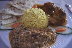 Indian meal with basamati rice. Daal and chicken curry stock images
