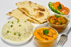 Indian Meal with Butter Chicken. Indian meal consisting of Butter chicken as the main dish, along with vegetable curry,Indian Bread,Rice and Salad Royalty Free Stock Photography