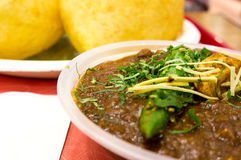 Indian meal of Chole (spicy chick peas) Bhature. Spicy indian meal of chick peas (chole) and fried bread (Bhature). Usually served for breakfast lunch or dinner Stock Photos