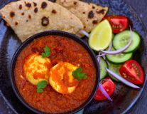Indian meal- egg curry and roti Royalty Free Stock Photography