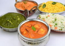 Indian Meal with Fish curry and boneless Chicken curry. Indian meal consisting of pulao, palak paneer fish curry chilly chicken and yellow rice Royalty Free Stock Images