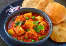 Indian meal matar paneer served with poori Stock Photos