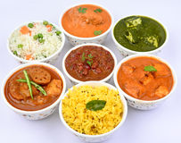 Indian Meal-Non vegetarian. Indian meal consisting of Rajma Palak paneer Mutton vindaloo Chicken korma Pulao yellow rice mix vegetable curry Stock Image