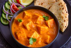 Indian meal-Punjabi Paneer butter masala and roti. Indian main course for lunch or dinner- Paneer butter masala curry,roti,Indian flatbread and salad stock image