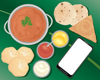 Indian meal with smart phone Stock Image