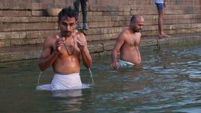 e61bab2c303 Indian men bathing at Ganges river in Varanasi. VARANASI, INDIA - 22  FEBRUARY 2015