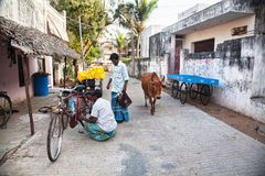 Indian men with bicycle Stock Images