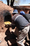Indian men cook in Clay Oven in South America Stock Photo