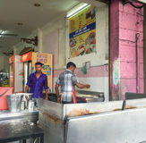 Indian men cooking street foods in Singapore Royalty Free Stock Photo