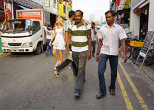Indian men going to the weekend market in Little India, Singapore Stock Photos