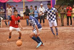 Indian men playing football Royalty Free Stock Photos