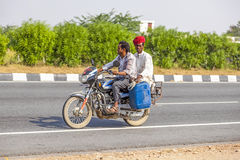 Indian men riding a scooter Stock Image