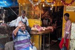 Indian men sell chicken on Russell Market in Bangalore Stock Image