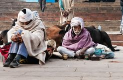 Indian men sit on the ghat near sacred river Ganges in Varanasi Royalty Free Stock Photography