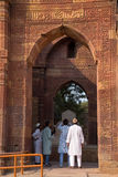 Indian men standing at the entrance to Tomb of Altamish, Qutub M Royalty Free Stock Photography