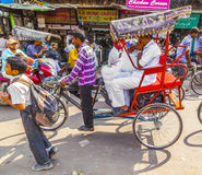 Indian men uses the rickshaw for Stock Photos