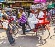 Indian men uses the rickshaw for Stock Photos