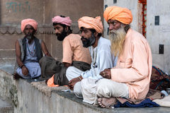 Indian Men Wearing Traditional Attire in Varanasi, India. Unidentified Indian men wearing traditional attire sitting by the ghats in Varanasi, Uttar Pradesh Stock Photography