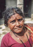 Indian miggle-aged woman. HAMPI, INDIA - 01 FEBRUARY 2015: Indian middle-aged woman with bindi on street in-front of home. Post-processed with grain, texture and stock photos