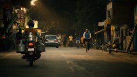 Indian milkman on distribution. Indian milkman on milk distribution on motorbike in evening Royalty Free Stock Photo