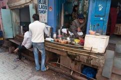 Indian milkman prepares the popular drink lassi in Blue lassi shop. VARANASI, INDIA - DEC 23, 2014: Unidentified Indian milkman prepares the popular drink lassi Royalty Free Stock Photo