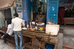 Indian milkman prepares the popular drink lassi in Blue lassi shop Royalty Free Stock Images