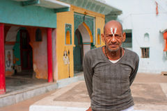 Indian elderly man near the hindu temple Royalty Free Stock Photos