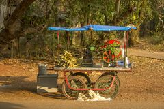 Indian mobile sugar cane juicer. street food royalty free stock photos