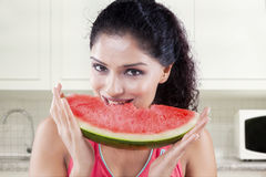 Indian model biting a piece of watermelon Stock Photos