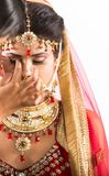 Indian model-bride getting ready for shoot stock image