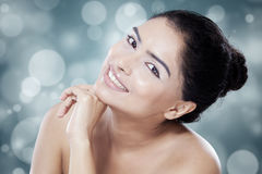 Indian model with fresh skin smiling Royalty Free Stock Photo