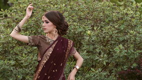 Indian model in a luxurious sari dress in the park stock video