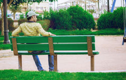 Indian Model seated on bench in park Royalty Free Stock Photos