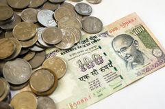 Indian money coins and paper on white Royalty Free Stock Photos