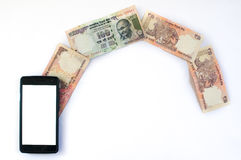 Indian money flowing from phone Royalty Free Stock Images
