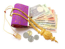 Indian Money and Gold. Close up of indian currency coming out from a purse and gold necklace Stock Images