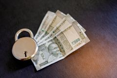 Indian money with lock , money protection concept.  royalty free stock image
