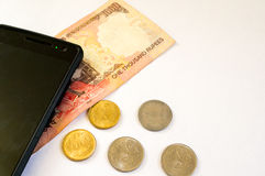 Indian money with mobile phone on white Stock Photos