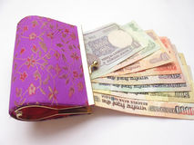 Indian Money and Purse. Close up Indian currency and ladies purse Royalty Free Stock Photo