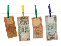 Indian Money on the Rope. Four 10 Rupee bills on a laundry rope Stock Photo