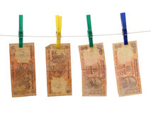 Indian Money on the Rope. Four 10 Rupee bills on a laundry rope Royalty Free Stock Photography